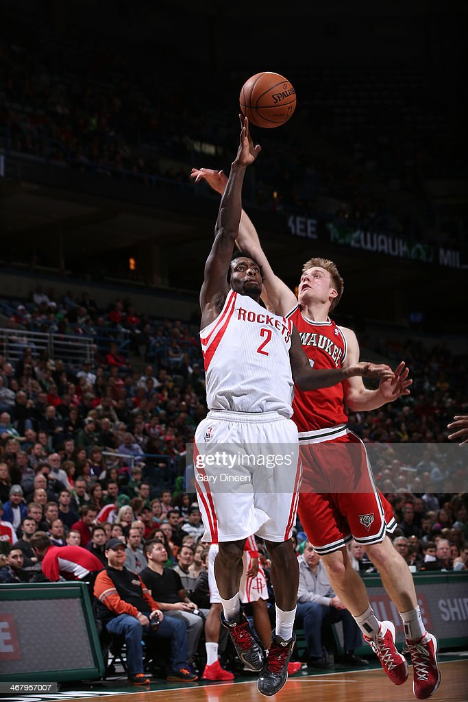 Patrick Beverly #2 of the Houston Rockets shoots against Nate Wolters #6 of the Milwaukee Bucks on February 8, 2014 at the BMO Harris Bradley Center in Milwaukee, Wisconsin.