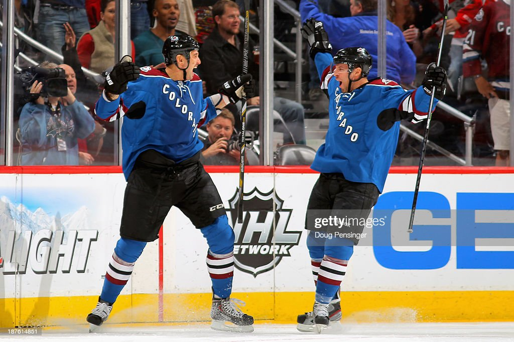 <a gi-track='captionPersonalityLinkClicked' href=/galleries/search?phrase=Patrick+Bordeleau&family=editorial&specificpeople=2282247 ng-click='$event.stopPropagation()'>Patrick Bordeleau</a> #58 of the Colorado Avalanche celebrates his against the Washington Capitals with Marc-Andre Cliche #24 of the Colorado Avalanche to give the Avalanche a 1-0 lead in the first period at Pepsi Center on November 10, 2013 in Denver, Colorado.