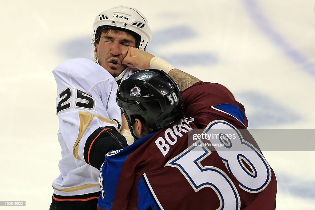 Patrick Bordeleau #58 of the Colorado Avalanche lands a punch on Brad Staubitz #25 of the Anaheim Ducks as they engage in a fight at the Pepsi Center on February 6, 2013 in Denver, Colorado.