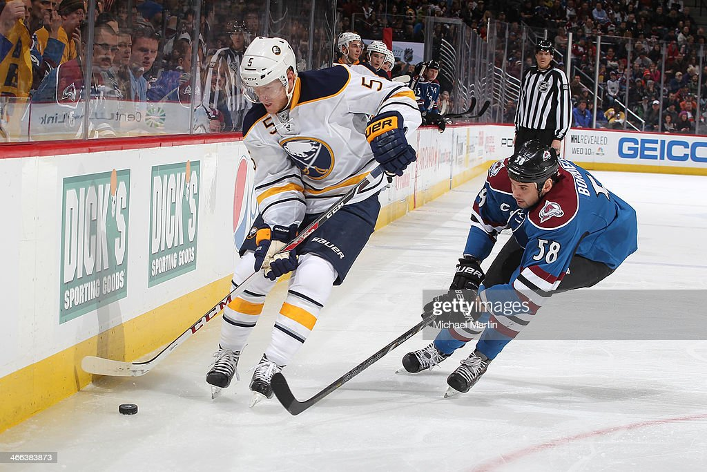 <a gi-track='captionPersonalityLinkClicked' href=/galleries/search?phrase=Patrick+Bordeleau&family=editorial&specificpeople=2282247 ng-click='$event.stopPropagation()'>Patrick Bordeleau</a> #58 of the Colorado Avalanche reaches for the puck as Chad Ruhwedel #5 of the Buffalo Sabres controls at the Pepsi Center on February 1, 2014 in Denver, Colorado.