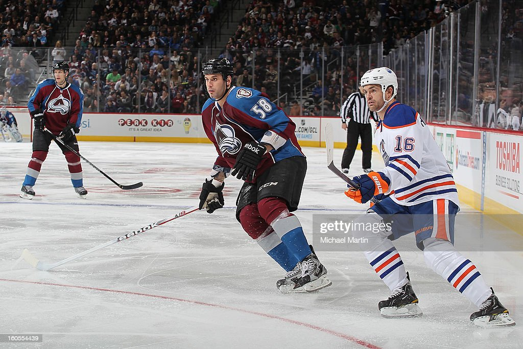 Patrick Bordeleau #58 of the Colorado Avalanche skates as <a gi-track='captionPersonalityLinkClicked' href=/galleries/search?phrase=Darcy+Hordichuk&family=editorial&specificpeople=213797 ng-click='$event.stopPropagation()'>Darcy Hordichuk</a> #16 of the Edmonton Oilers defends nearby at the Pepsi Center on February 2, 2013 in Denver, Colorado. The Avalanche went on to win 3-1.