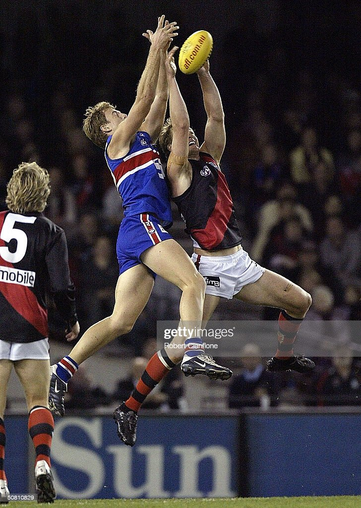 Patrick Bowden of the Bulldogs challenges Sean Wellman#6 of the Bombers during the round seven AFL match between the Western Bulldogs and the...