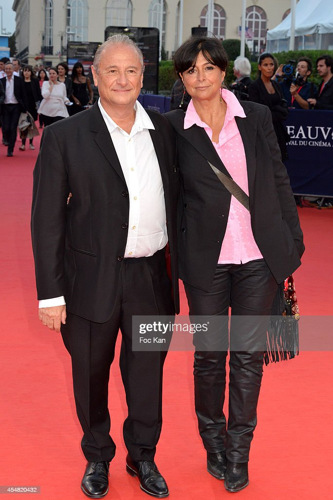 Patrick Braoude and his wife Guila arrive at the The Hundred Foot Journey' Premiere 40th Deauville American Film Festival at the CID on September 6...