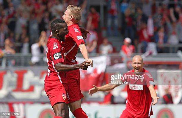 Patrick Breitkreuz of Cottbus jubilates with team mates after scoring the first goal during the third league match between FC Energie Cottbus and...