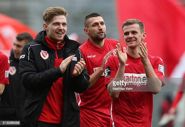 Patrick Breitkreuz Torsten Mattuschka and Manuel Zeitz of Cottbus show their delight after winning the third league match between FC Energie Cottbus...
