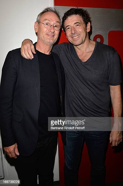 Patrick Bruel and Singer Michael Jones backstage after Patrick Bruel's concert at Zenith de Paris on May 29 2013 in Paris France