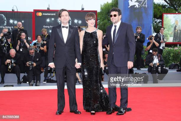 Patrick Bruel Micaela Ramazzotti and Sebastiano Riso walk the red carpet ahead of the 'Una Famiglia' screening during the 74th Venice Film Festival...