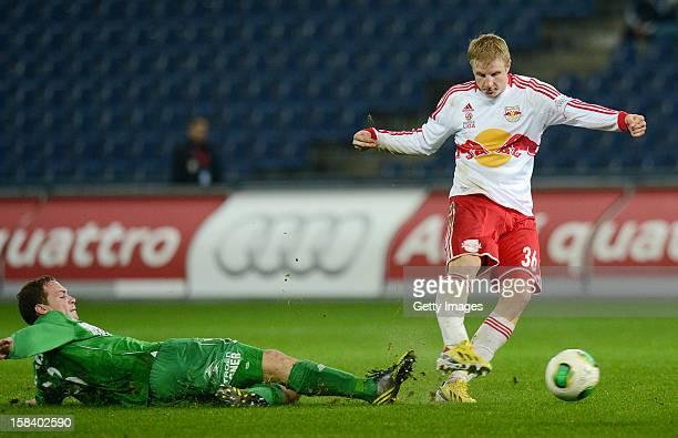 Patrick Buerger of Mattersburg challenges Martin Hinteregger of Salzburg during the tipp3 Bundesliga match between Red Bull Salzburg and SV...