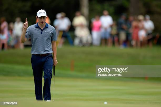 Patrick Cantlay acknowledges the crowd as he walks to the 18th green during round three of the 2013 Hotel Fitness Championship at Sycamore Hills Golf...