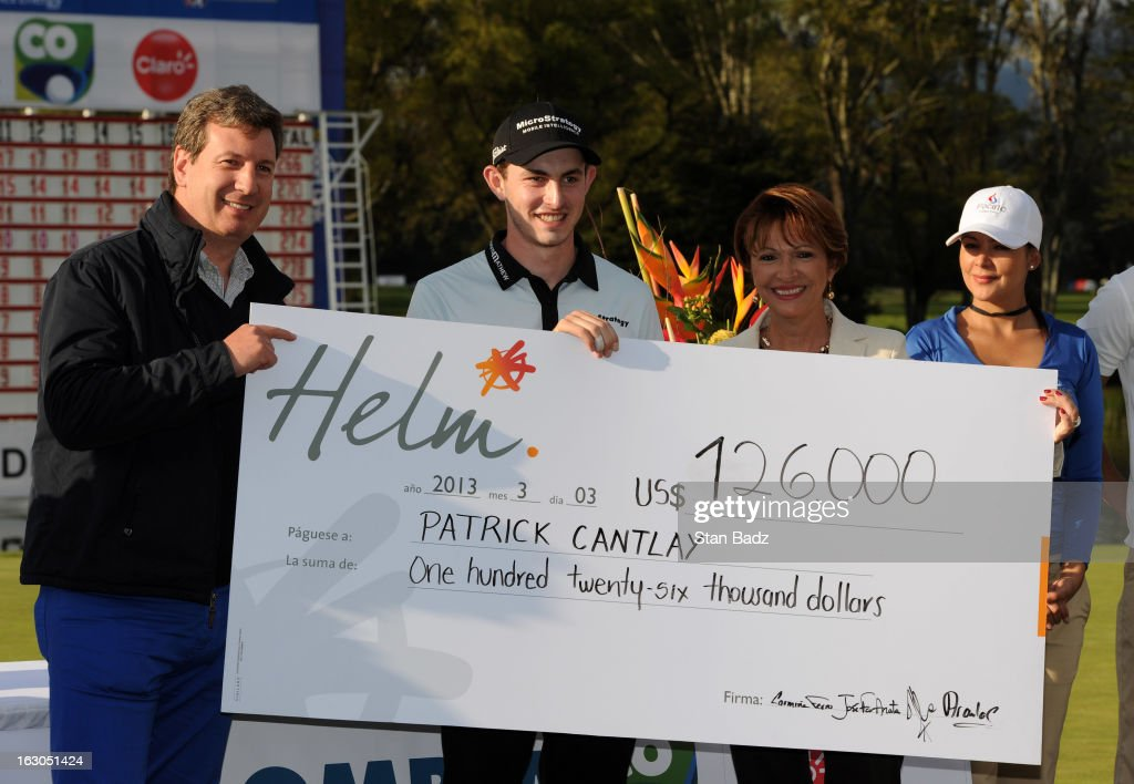 Patrick Cantlay is presented the winner's check on the 18th green during the final round of the Colombia Championship at Country Club de Bogota on March 3, 2013 in Bogota, Colombia.