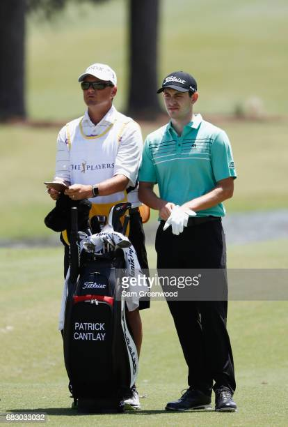 Patrick Cantlay of the United States and his caddie Matt Minister prepare to play on the first hole during the final round of THE PLAYERS...