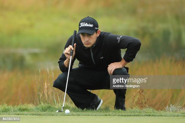 Patrick Cantlay of the United States lines up a putt on the second green during round three of the Dell Technologies Championship at TPC Boston on...