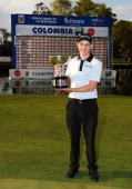 Patrick Cantlay poses with the winner's trophy after playing the final round of the Colombia Championship at Country Club de Bogota on March 3 2013...
