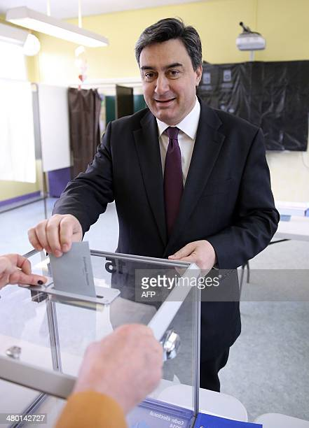 Patrick Cassany French Socialist Party mayor of VilleneuvesurLot and candidate for his own succession smiles as he casts his ballot in the first...