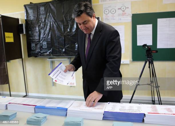 Patrick Cassany French Socialist Party mayor of VilleneuvesurLot and candidate for his own succession picks up ballots before voting in the first...