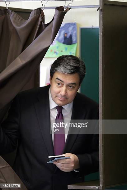 Patrick Cassany French Socialist Party mayor VilleneuvesurLot and candidate for his own succession steps out of a voting booth before casting his...