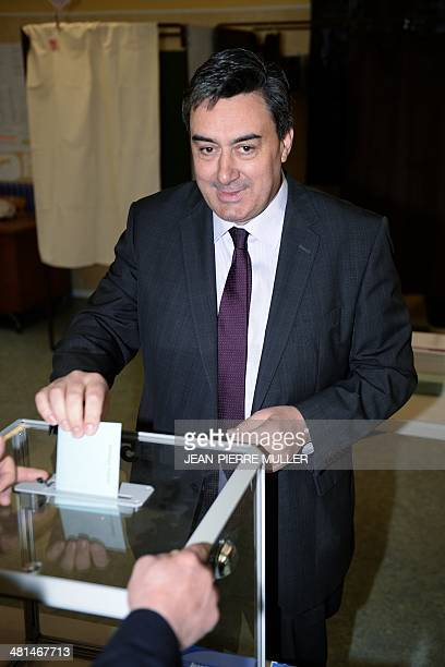Patrick Cassany French Socialist Party's candidate for the mayoral election in VilleneuvesurLot casts his ballot at a polling station during the...