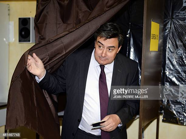 Patrick Cassany French Socialist Party's candidate for the mayoral election in VilleneuvesurLot steps out of a polling booth before voting during the...