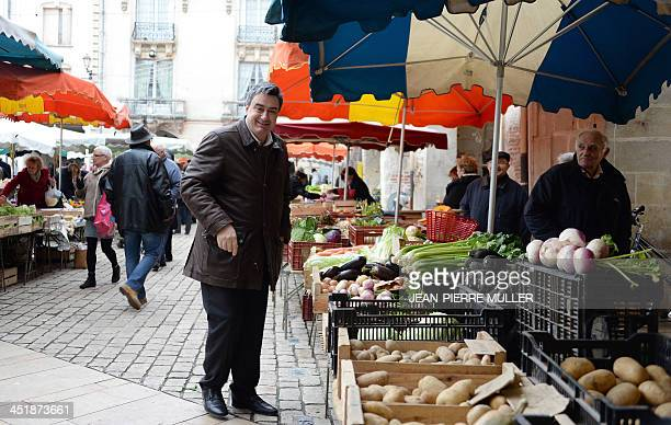 Patrick Cassany socialist mayor of VilleneuvesurLot and candidate for his own succession in the upcoming municipal elections visits a market as part...