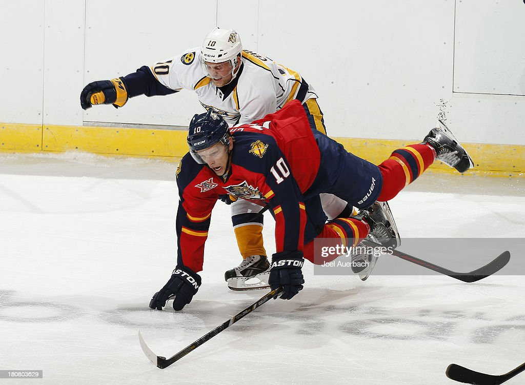 Patrick Cehlin of the Nashville Predators trips Joey Crabb of the Florida Panthers during a preseason game at the BBT Center on September 16 2013 in...