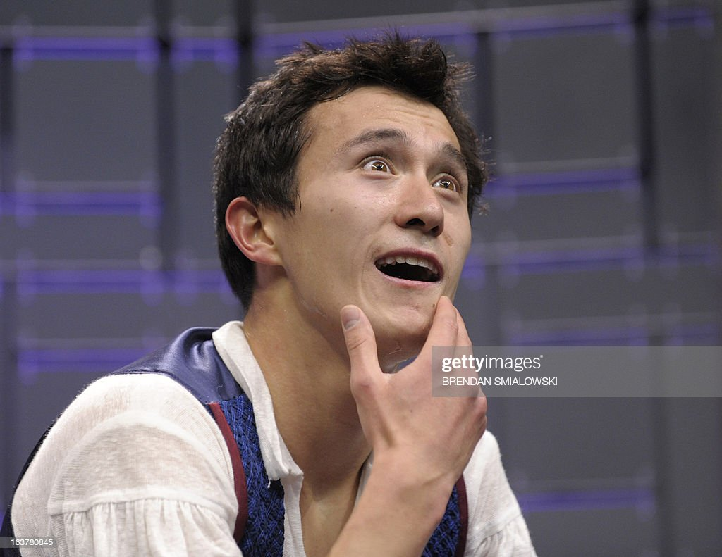 Patrick Chan competing for Canada reacts to his scores in the Men's Free Skate event at the 2013 World Figure Skating Championships March 15, 2013 in London, Ontario, Canada. AFP PHOTO/Brendan SMIALOWSKI