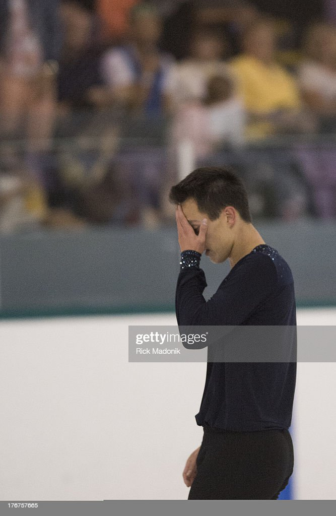 THORNHILL, ON- AUGUST 18 - Patrick Chan doesn't appear all that happy with his routine after the finish at Skate Canada Summer Skate event in Thornhill, August 18, 2013. The event was held at the Thornhill Community Centre. Chan unveiled this season's Free Program.