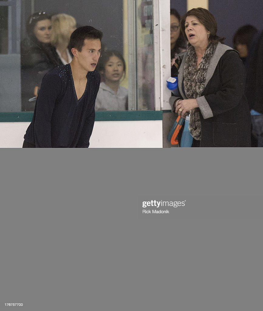 THORNHILL, ON- AUGUST 18 - Patrick Chan doesn't appear all that happy with his routine after the finish, while talking with coach Kathy Johnston, at Skate Canada Summer Skate event in Thornhill, August 18, 2013. The event was held at the Thornhill Community Centre. Chan unveiled this season's Free Program.