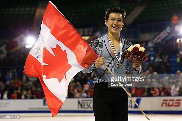 Patrick Chan of Canada celebrates his gold medal victory during the men's free program on day two at the ISU GP 2013 Skate Canada International at...