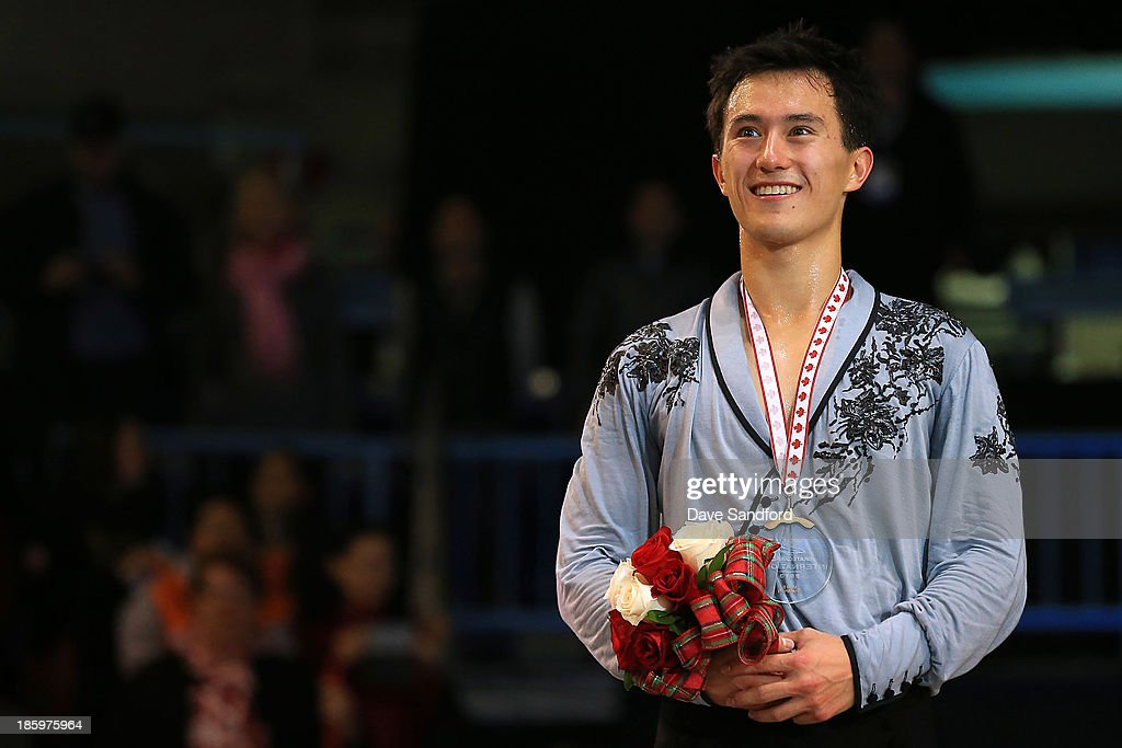 <a gi-track='captionPersonalityLinkClicked' href=/galleries/search?phrase=Patrick+Chan&family=editorial&specificpeople=4036503 ng-click='$event.stopPropagation()'>Patrick Chan</a> of Canada celebrates his gold medal victory during the men's free program on day two at the ISU GP 2013 Skate Canada International at Harbour Station on October 26, 2013 in Saint John, New Brunswick, Canada.