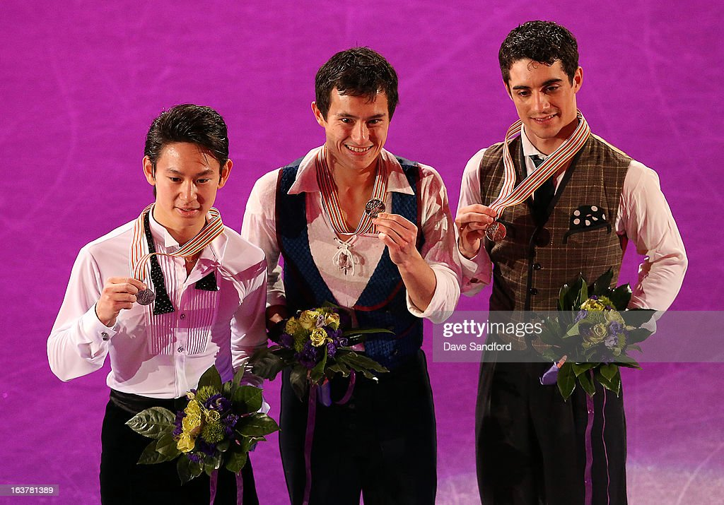 Patrick Chan of Canada (Middle) celebrates winning gold with Denis Ten of Kazakhstan (left) with silver and Javier Fernandez of Spain with bronze in the Mens Free Skating Program during the 2013 ISU World Figure Skating Championships at Budweiser Gardens on March 15, 2013 in London, Ontario, Canada.