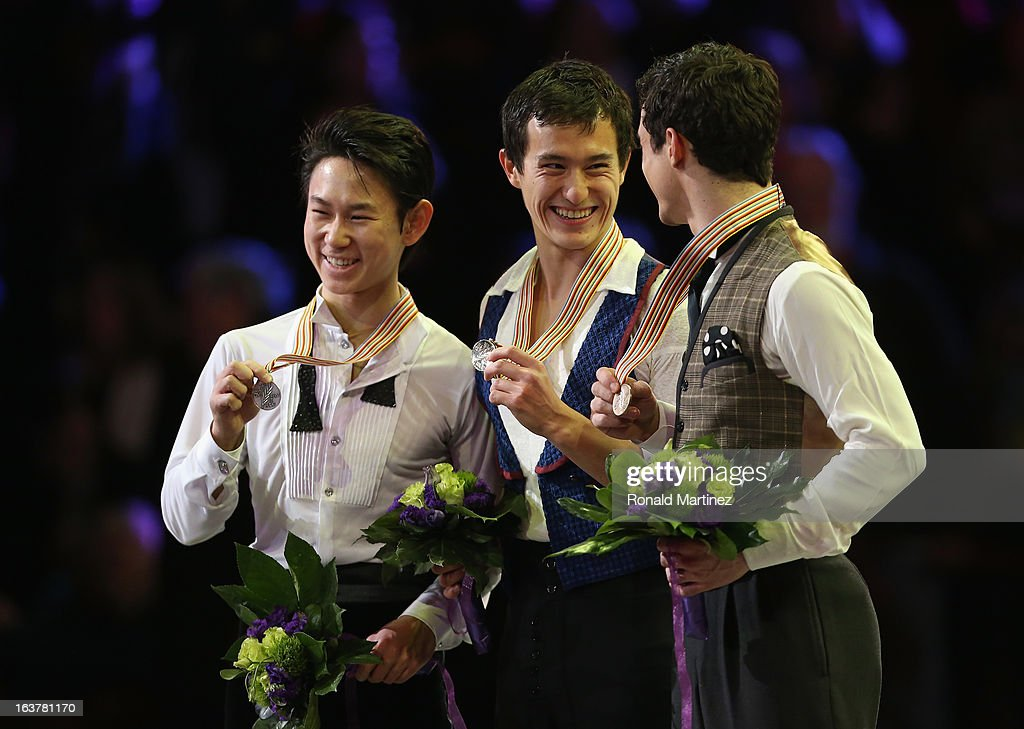 Patrick Chan of Canada (C) celebrates winning the gold medal with Denis Ten of Kazakhstan (L) winning silver medal and Javier Fernandez of Spain winning the bronze medal in the Mens Free Skating during the 2013 ISU World Figure Skating Championships at Budweiser Gardens on March 15, 2013 in London, Canada.
