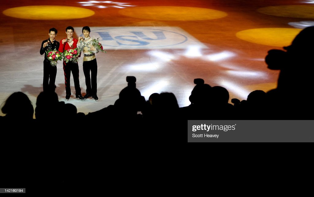 Patrick Chan of Canada Daisuke Takahashi of Japan and Yuzuru Hanyu of Japan pose for photographs after receiveing their medals performs during day...