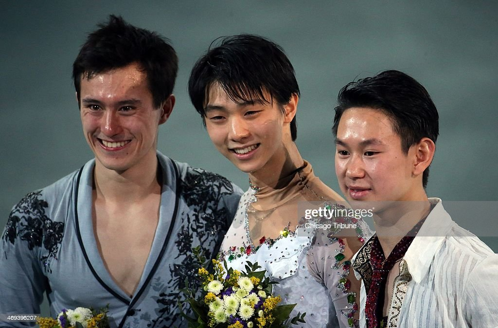 Patrick Chan (left to right), Yuzuru Hanyu and Denis Ten smile after winning medals in figure skating at the Iceberg Skating Palace during the Winter Olympics in Sochi, Russia, Friday, Feb. 14, 2014. Hanyu won the gold, Chan the silver and Ten the bronze.