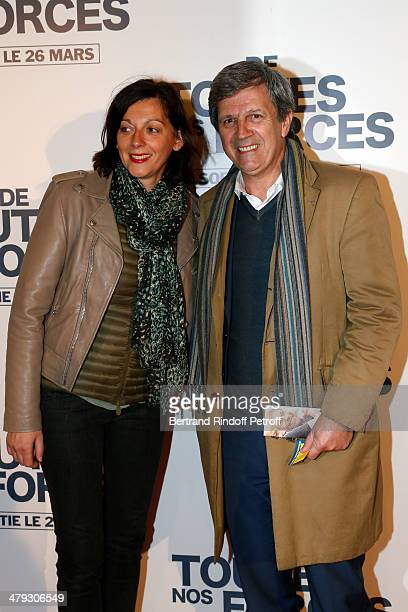 Patrick Chêne and his wife at Gaumont Capucines on March 17 2014 in Paris France