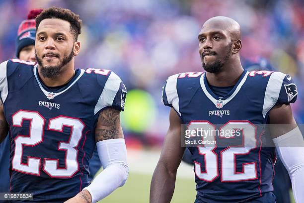 Patrick Chung and Devin McCourty of the New England Patriots walk into the locker rooms at halftime during the game against the Buffalo Bills on...