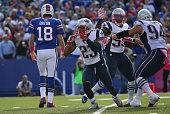 Patrick Chung of the New England Patriots celebrates after a sack during NFL game action of Kyle Orton of the Buffalo Bills at Ralph Wilson Stadium...