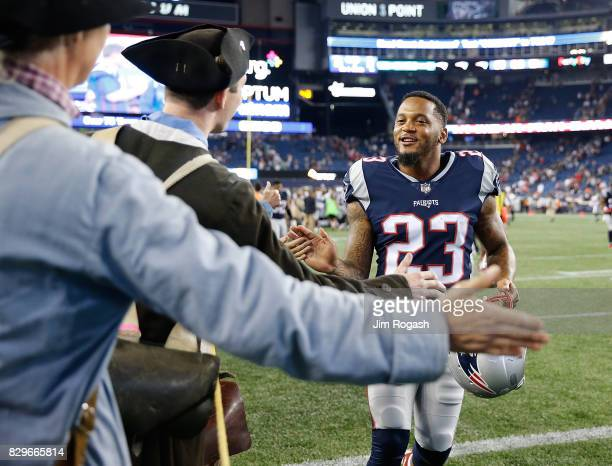 Patrick Chung of the New England Patriots interacts with the End zone Militia after a preseason game with the Jacksonville Jaguars at Gillette...