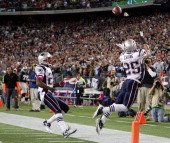 Patrick Chung of the New England Patriots intercepts Dallas Cowboys quarterback Tony Romo's hail mary pass in the final seconds of the game on...