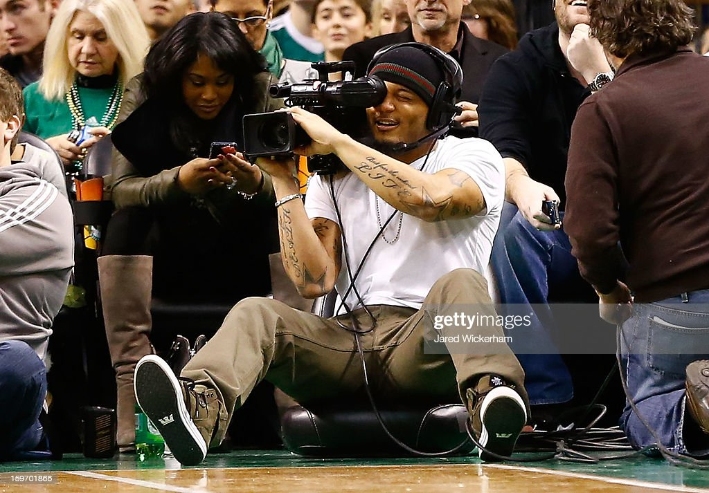 Patrick Chung of the New England Patriots sits courtside as the videographer during the game between the Boston Celtics and the Chicago Bulls on January 18, 2013 at TD Garden in Boston, Massachusetts.