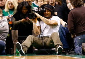 Patrick Chung of the New England Patriots sits courtside as the videographer during the game between the Boston Celtics and the Chicago Bulls on...