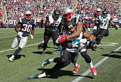 Patrick Chung of the New England Patriots stops Corey Grant of the Jacksonville Jaguars in the first half at Gillette Stadium on September 27 2015 in...