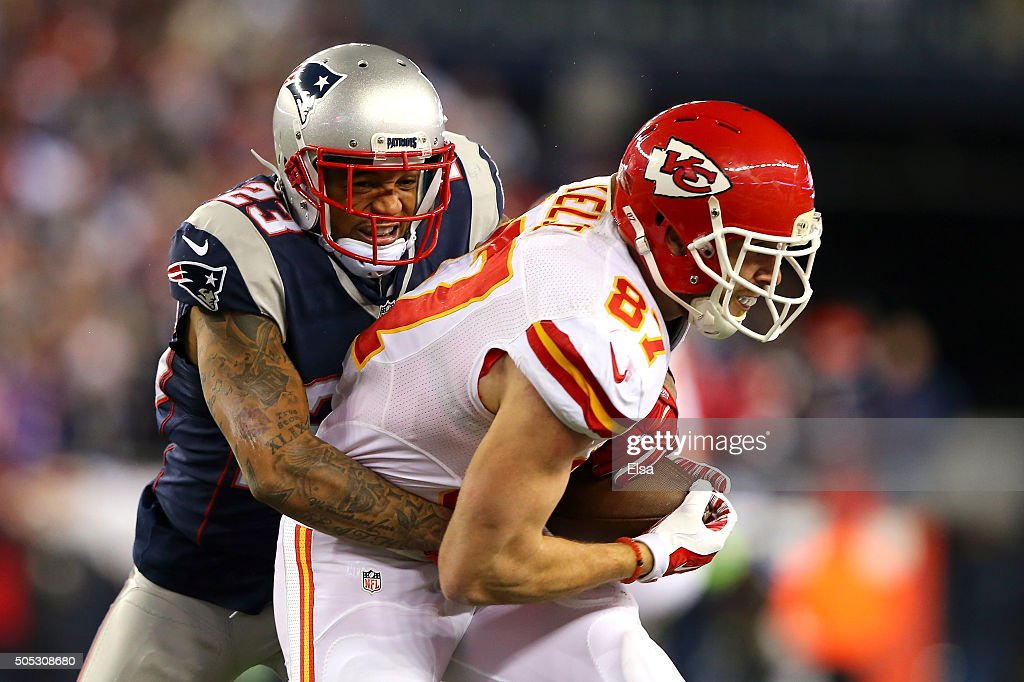 <a gi-track='captionPersonalityLinkClicked' href=/galleries/search?phrase=Patrick+Chung&family=editorial&specificpeople=2242933 ng-click='$event.stopPropagation()'>Patrick Chung</a> #23 of the New England Patriots tries to tackle <a gi-track='captionPersonalityLinkClicked' href=/galleries/search?phrase=Travis+Kelce&family=editorial&specificpeople=6237659 ng-click='$event.stopPropagation()'>Travis Kelce</a> #87 of the Kansas City Chiefs in the second half during the AFC Divisional Playoff Game at Gillette Stadium on January 16, 2016 in Foxboro, Massachusetts.