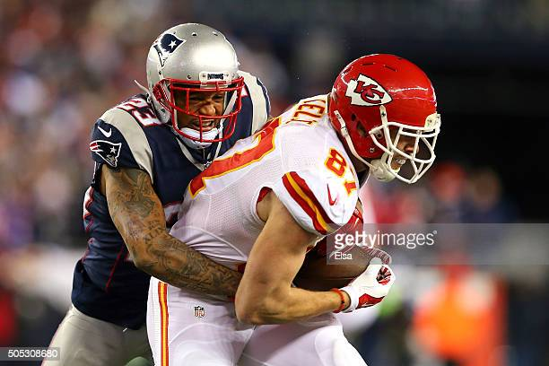 Patrick Chung of the New England Patriots tries to tackle Travis Kelce of the Kansas City Chiefs in the second half during the AFC Divisional Playoff...
