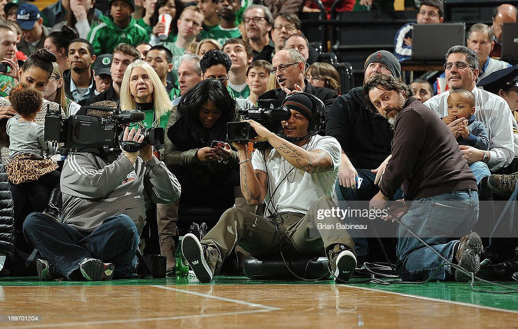 Patrick Chung of the New England Patriots uses one of the in house cameras during the game of the Boston Celtics against the Chicago Bulls on January 18, 2013 at the TD Garden in Boston, Massachusetts.