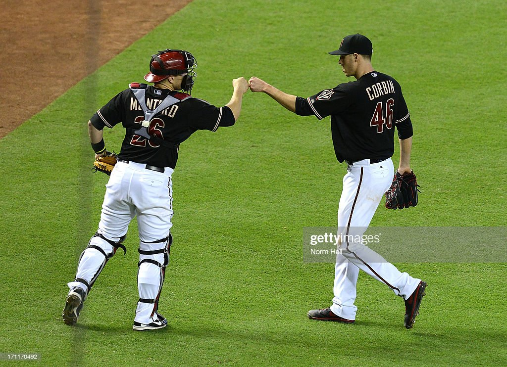 <a gi-track='captionPersonalityLinkClicked' href=/galleries/search?phrase=Patrick+Corbin+-+Baseball+Player&family=editorial&specificpeople=10882576 ng-click='$event.stopPropagation()'>Patrick Corbin</a> #46 and teammate <a gi-track='captionPersonalityLinkClicked' href=/galleries/search?phrase=Miguel+Montero&family=editorial&specificpeople=836495 ng-click='$event.stopPropagation()'>Miguel Montero</a> #26 of the Arizona Diamondbacks celebrate finishing the eighth inning against the Cincinnati Reds at Chase Field on June 22, 2013 in Phoenix, Arizona.