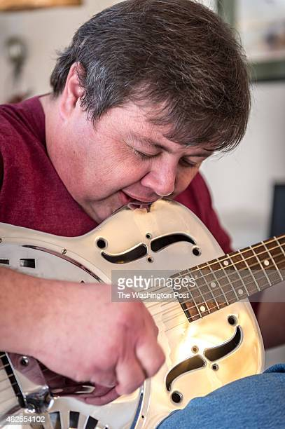 Patrick Costello III of Manassas Va plays guitar by sensing the string vibrations through his teeth as he did when he was nearly completely deaf...