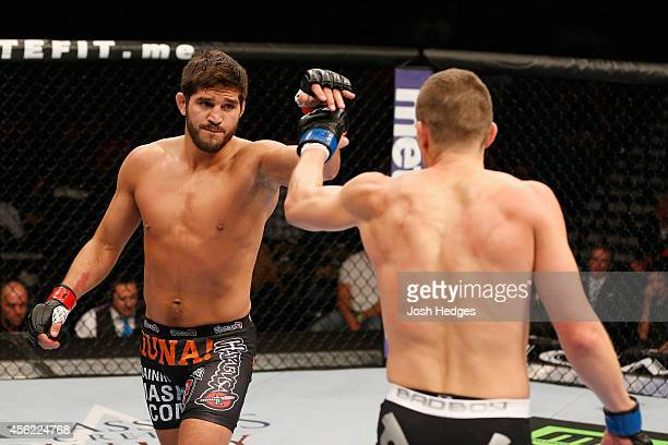 Patrick Cote and Stephen Thompson begin Round 2 in their welterweight fight during the UFC 178 event inside the MGM Grand Garden Arena on September...