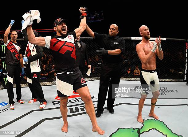 Patrick Cote celebrates after his TKO victory over Josh Burkman in their welterweight bout during the UFC event at the SaskTel Centre on August 23...