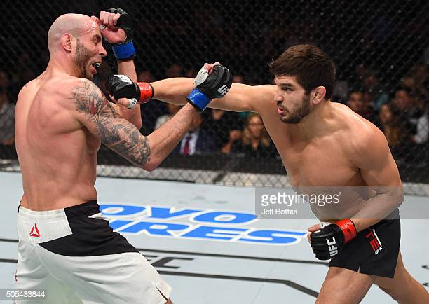 Patrick Cote of Canada punches Ben Saunders in their welterweight bout during the UFC Fight Night event inside TD Garden on January 17 2016 in Boston...