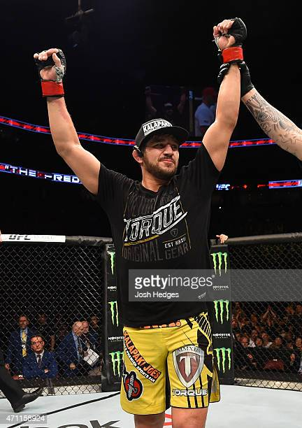 Patrick Cote of Canada reacts after his decision victory over Joe Riggs of the United Sates in their welterweight bout during the UFC 186 event at...